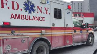 FDNY EMS AMBULANCE TRANSPORTING ON 174TH STREET IN THE WEST FARMS, THE BRONX IN NEW YORK CITY.