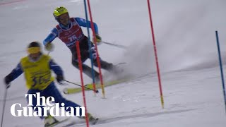 World Cup slalom skier interrupted by course worker on slopes