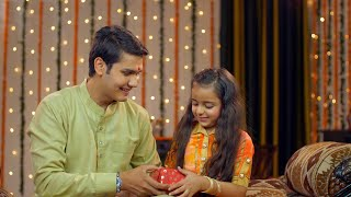 Indian brother gifting her cute little sister her rakhi gift -  Raksha Bandhan concept