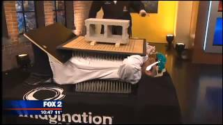 Crushing a block while laying on a bed of nails