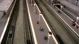 Model railway station and control panel