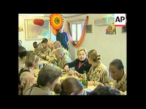 WRAP Hillary Clinton has Thanksgiving dinner with US troops