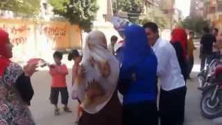 رقص أمام اللجان بمحافظة الفيوم  مدرسة التجارة بحى الجون