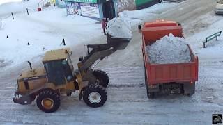 Фронтальный погрузчик Mitsuber, погрузка Камаза(Уборка снега с улицы с помощью фронтального погрузчика Mitsuber, который с легкостью грузит Камаз 6520 спрессова..., 2015-02-19T17:35:46.000Z)