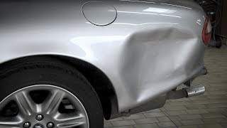Repair of a damaged side panel on a Jaguar convertible with the Miracle-System.