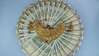 Top view shot of five hundred banknotes with jewels - gold loan or gold mortgage