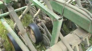 Close up look of how a John Deere No-till drill Plants Sorghum for Haunted Maze