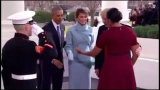 Melania Trump gives a gift to Michelle Obama as the Obamas welcome the Trumps to the White House