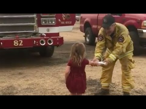 Little girl hands burritos to firefighters battling Carr Fire