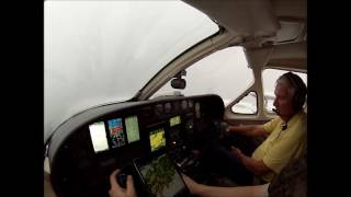 Landing Cessna 421 RNAV approach to minimums in heavy rain.