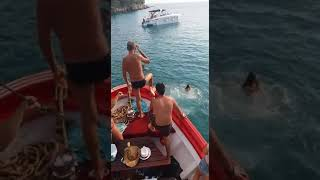 Vibes  guy slips on red boat falls into water
