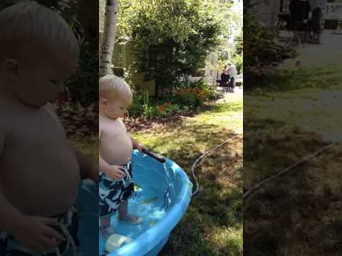 Chandler plays in the pool at Grandma's - 18 months