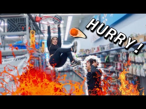 THE FLOOR IS LAVA CHALLENGE IN WALMART!!! (WE GOT KICKED OUT...)