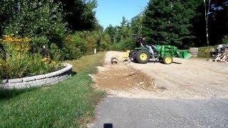 using 6 landscape rake on a john deere 2032r to rake rocks in driveway