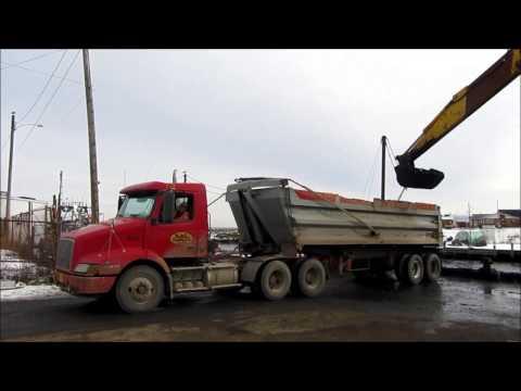 Trucks Hauling From Harbour Dredging