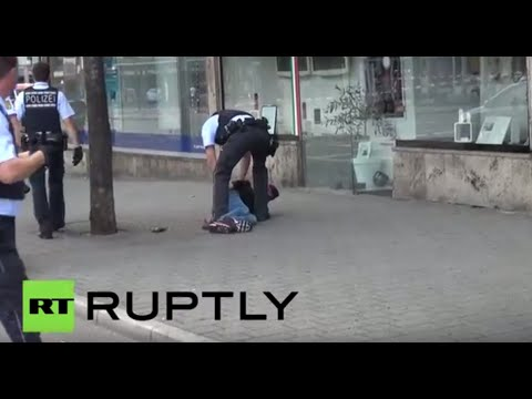 Moment German police arrest machete wielding Syrian refugee in Reutlingen