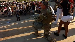 Minnesota soldier hugs protesters at Capitol