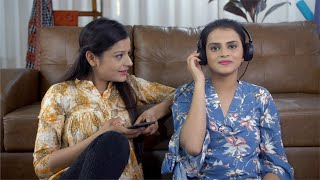 Pretty looking young Indian girls listening to music together