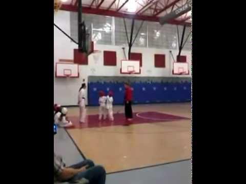 Gianna in Karate class kick boy below the belt
