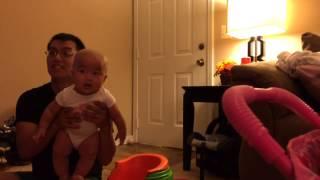 Big sister making baby brother laugh