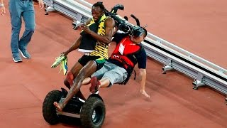 Download Video Chinese Cameraman falls on Usain Bolt -  Usain Bolt accident with cameramen.Болта сбил оператор MP3 3GP MP4