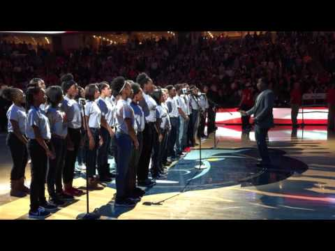 Mabelvale Middle School choir sings national anthem at grizzlies game