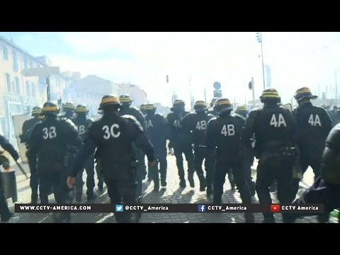EuroCup soccer fans clash with riot police in Marseille