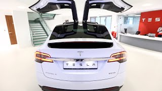 Tesla Shares Fall as Deliveries Flatline