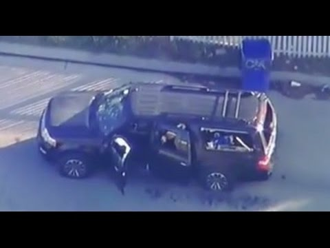 CRAZY FOOTAGE: SHOT UP VEHICLE, BLOOD IN THE STREET IN SAN BERNARDINO CALIFORNIA.