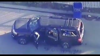 CRAZY FOOTAGE: SHOT UP VEHICLE, BLOOD IN THE STREET IN SAN BERNARDINO CALIFORNIA.