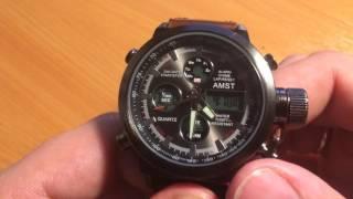 Як налаштувати будильник на годиннику AMST
