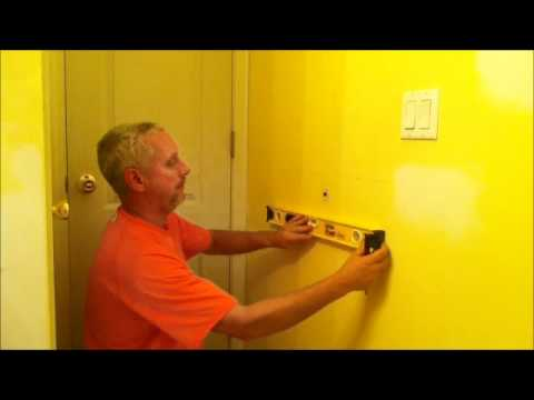Episode I fix a door knob hole in drywall - YouTube