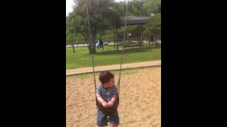 Simon swinging at Pine Gully Park