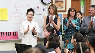 First ladies of China, US visit Florida art school, meet students