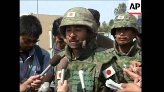 Japanese troops set up road project