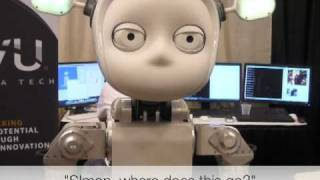 Simon the robot learns to clean up
