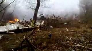 On Amateur Footage Of Polish Plane Crash, @ 0:57 Gun Shots Start Going Off !!