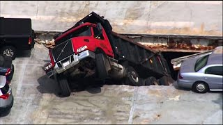 Dump truck collapses through MA parking garage