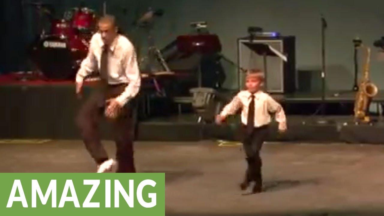 Tap dance showdown between young boy and seasoned pro