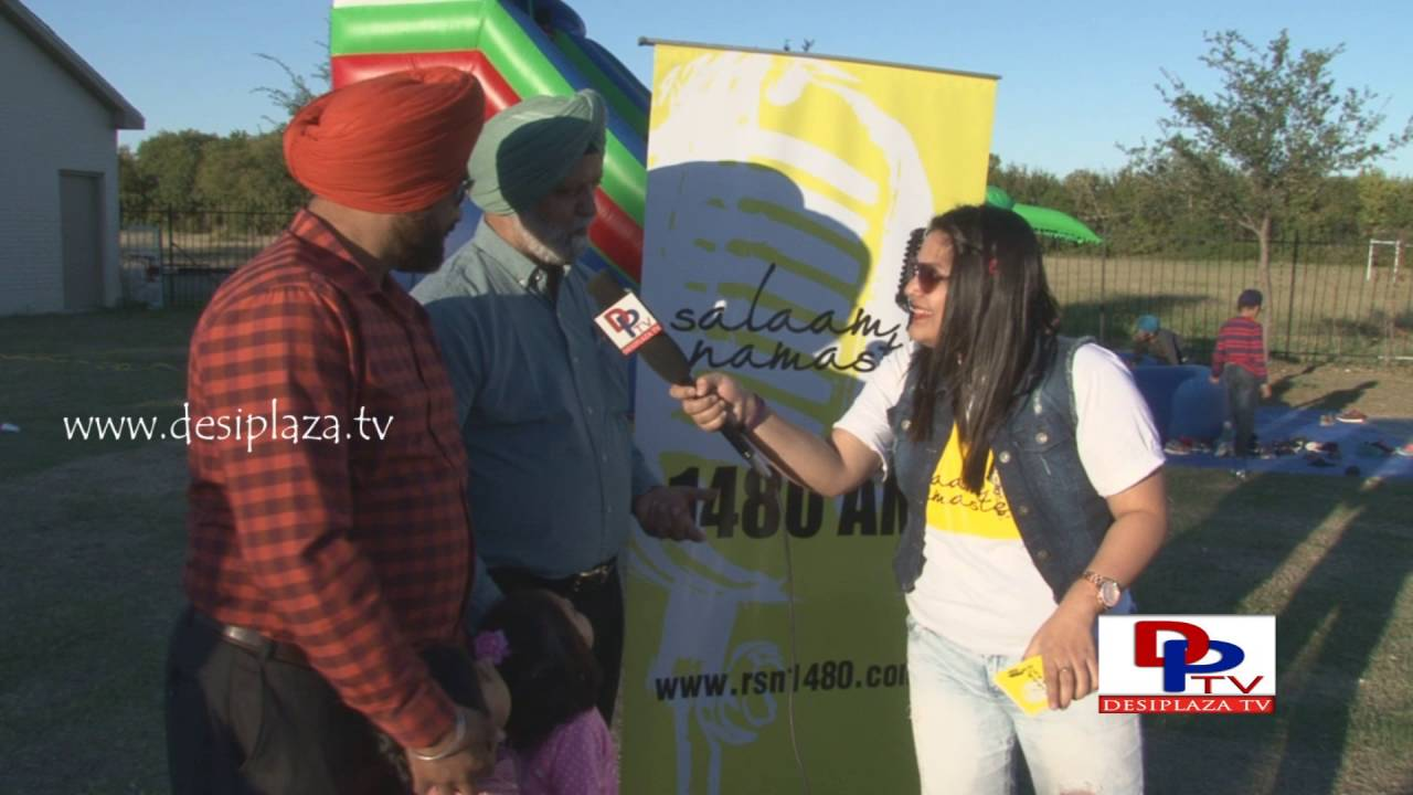 Men at Khed Mela talking to Desiplaza in Salam Namaste promotions