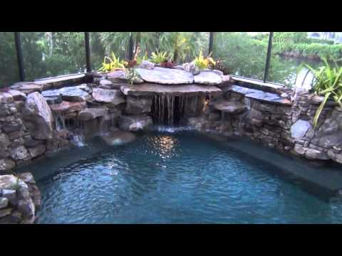 Pool Construction Completed Fitting Several Tons of Natural Stone in a Small Area with Waterfalls