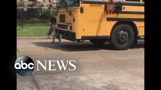 Car blows past school bus stop sign, nearly hitting child
