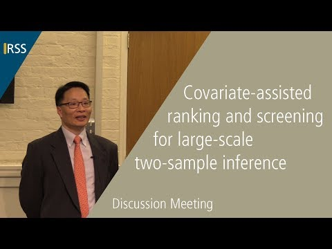 Covariate-assisted ranking and screening for large-scale two-sample inference
