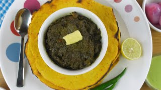 Traditional Punjabi cuisine Makki Ki Roti and Saag served in ceramic bowl and plate