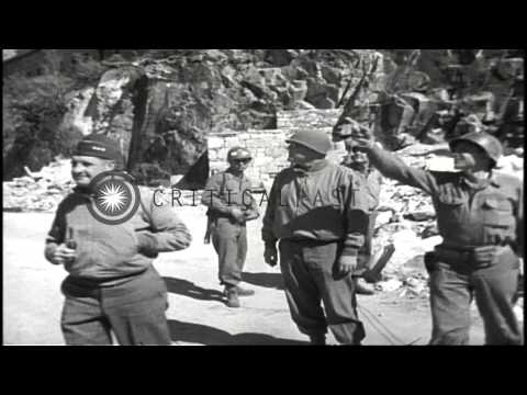 US Lieutenant General Geoffrey Keyes inspects German small arms in Italy during W...HD Stock Footage