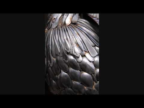 John Lopez Sculptures / welded silverware peacock