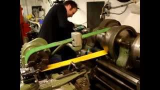 Lathe powered by a lathe