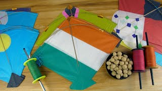 Happy Makar Sankranti festival with different colorful kites and sweets - pan shot