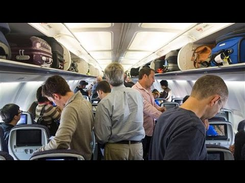 Middle Seat: The Overhead Luggage Problem
