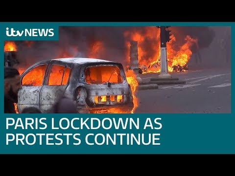 Water cannon and tear gas fired on Paris protesters as hundreds arrested | ITV News